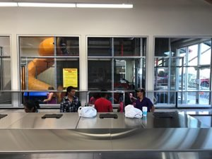 kid-friendly coin laundromat - play area viewing window