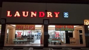 Sam Laundromat - exterior at night - everyone needs clean laundry